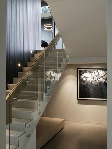 Staircase with wide wooden handrail