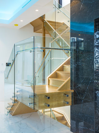 Pin fixed staircase with custom handrail