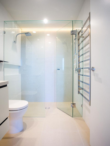 His and her inline frameless showerscreen