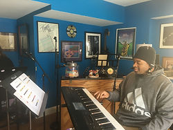 One of JAM's musicians playing the keyboard