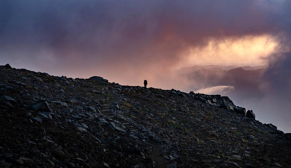 wanderer rainier mountaineering mountain hiking rocks clouds landscape