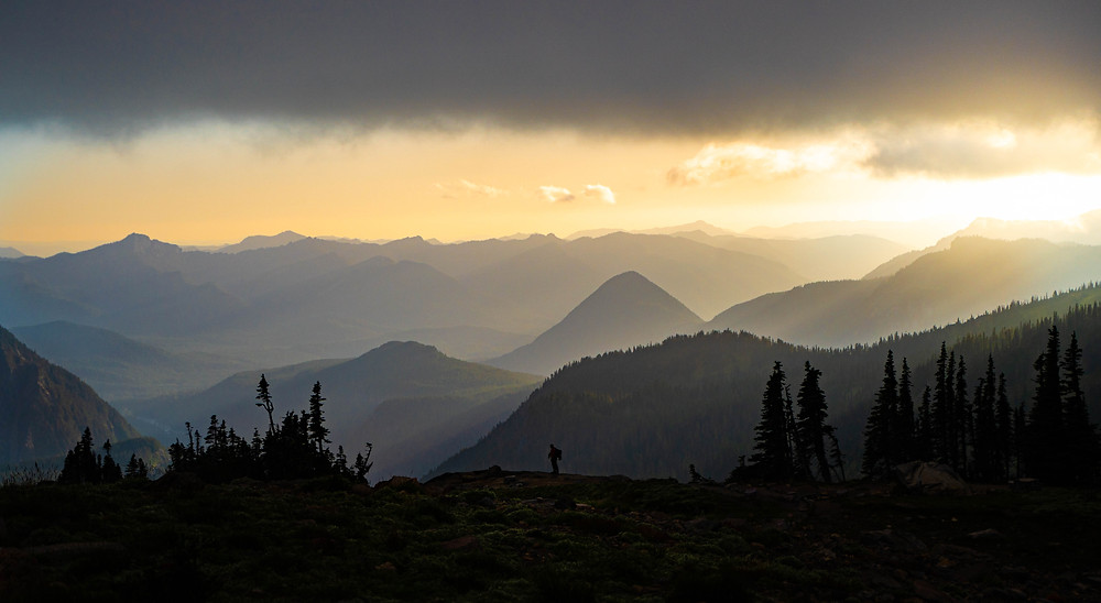alone wanderer landscape mountains trees sunset sun distance haze