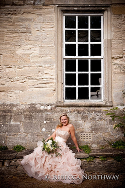 Strapless pink ruffle wedding dress