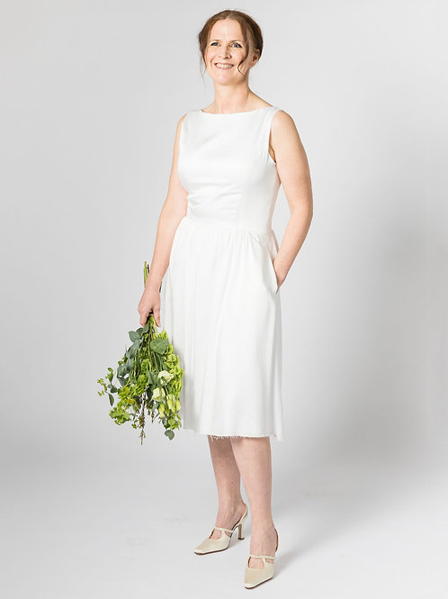 knee length sustainable wedding dress bamboo silk with pockets front view