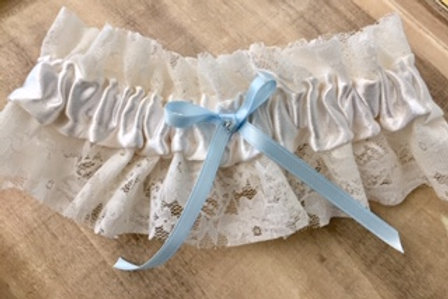 handmade sustainable wedding garter made from reclaimed lace and blue ribbon