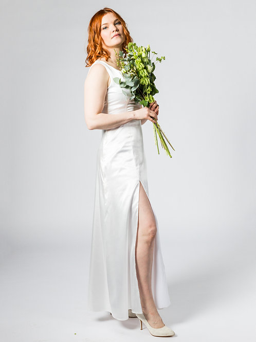 recycled plastic bottle sustainable full length wedding dress with low neck and high split hollywood glamour