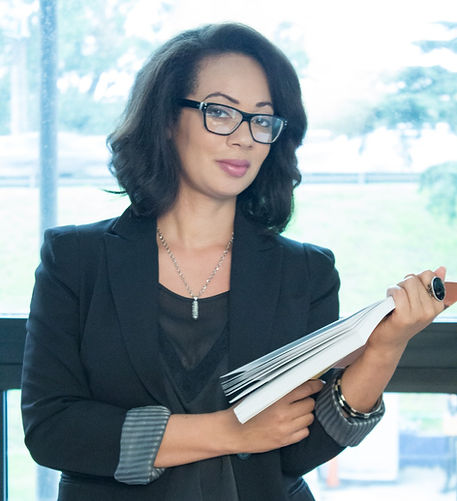 Janice_pic_with book_edited.jpg