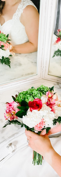 Bridal reflection with bouquet