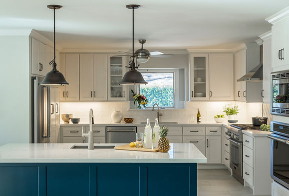 Industrial Modern Kitchen with white cabinets, blue island and stainless steel appliances