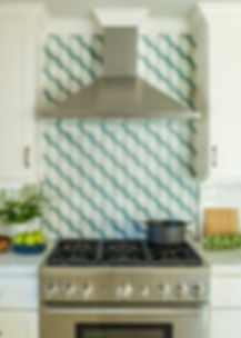 Geometric backsplash tile with industrial range hood