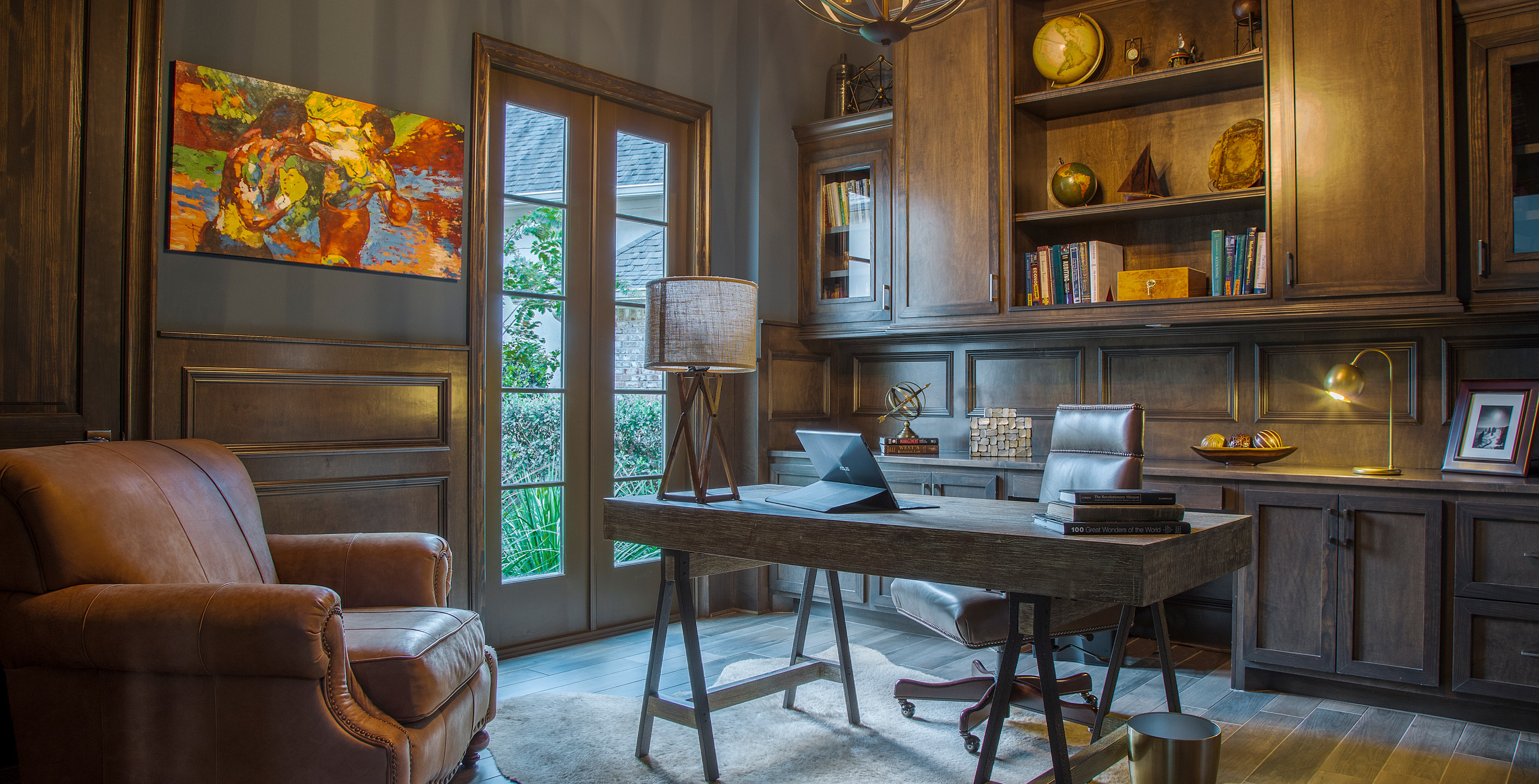modern, transitional office. interior designer in the woodlands, tx. Spring and Houston, TX. Masculine office with wood tones and leather chair. interior designer in houston