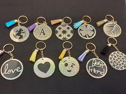 Porte clé avec motifs holographiques dorés et prénom