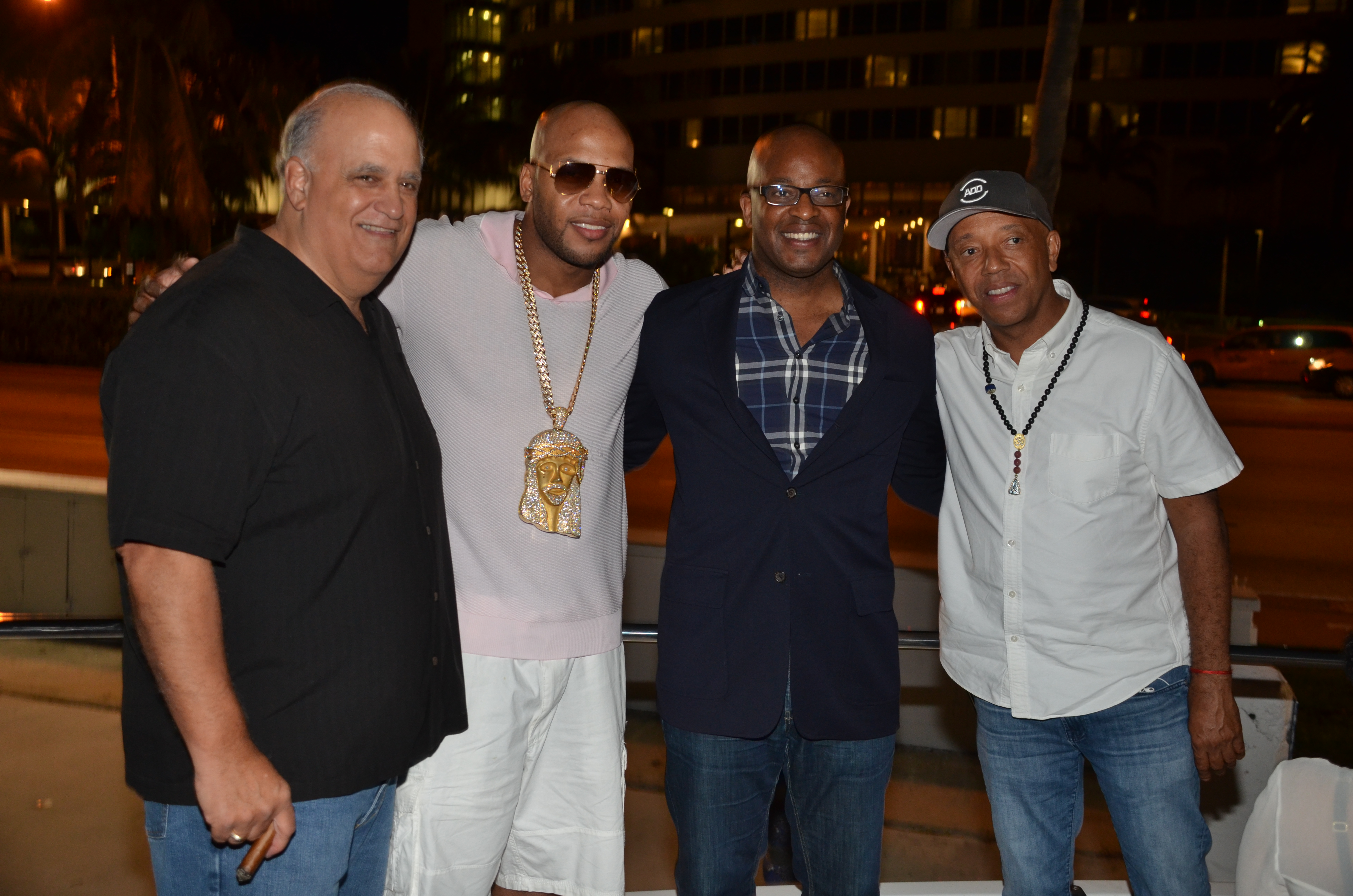 Celsius CEO Gerry David, Flo Rida, Frank Cooper, Russell Simmons at Revolt Music Conference Yacht Pa