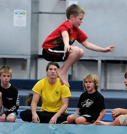 Boy Tuck Jump with coach