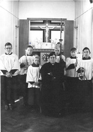 Fr Dennis and members of the serving team in the church hall before the current Church was built