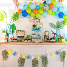 Dinosaur party cake treat table decor