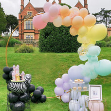 Luxury balloons arch loop Maleficent party cake table