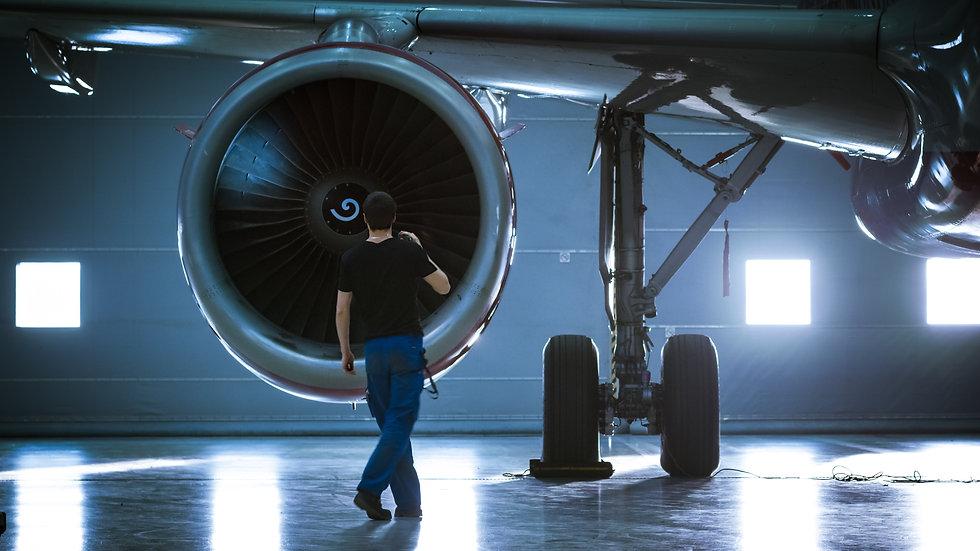 In a Hangar Aircraft Maintenance Enginee