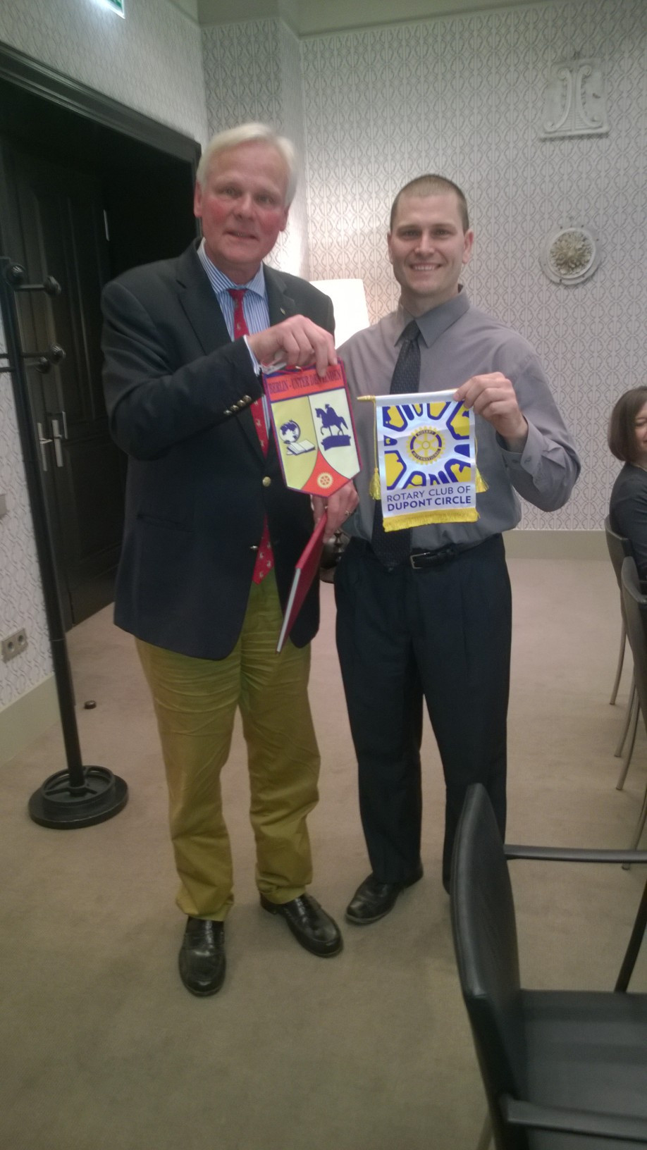 Dupont Rotary President Bryan Schaaf exchanges Rotary banners with a member of the Unter Den Linden Rotary Club in Berlin