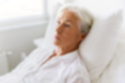 sml-sad-senior-woman-lying-on-bed-at-hos