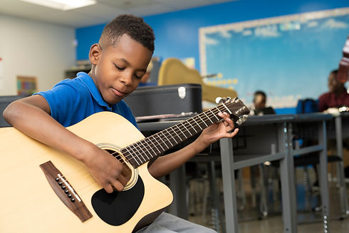 COP student learning guitar