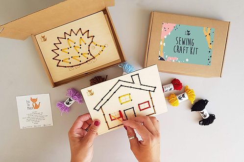Wooden sewing card with plastic needle