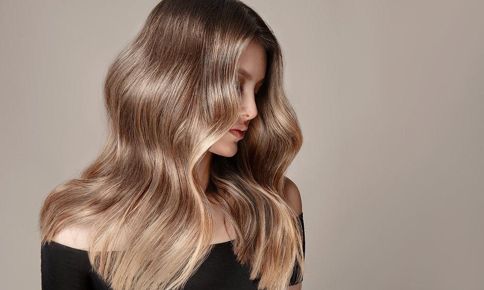 Beauty  girl with long  and   shiny wavy  Hair ,coloring and toning, shatush and balayash