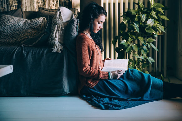 woman-sits-on-the-floor-reading.jpg