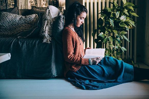 woman-sits-on-the-floor-readingWEB.jpg