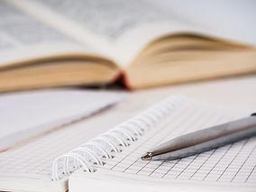 Metallic pen, spiral squared paper noteb