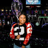 4 Yound woman with ballon Holiday lights video board PLS19040 (1).jpg