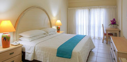 Chaconia Deluxe King Room b