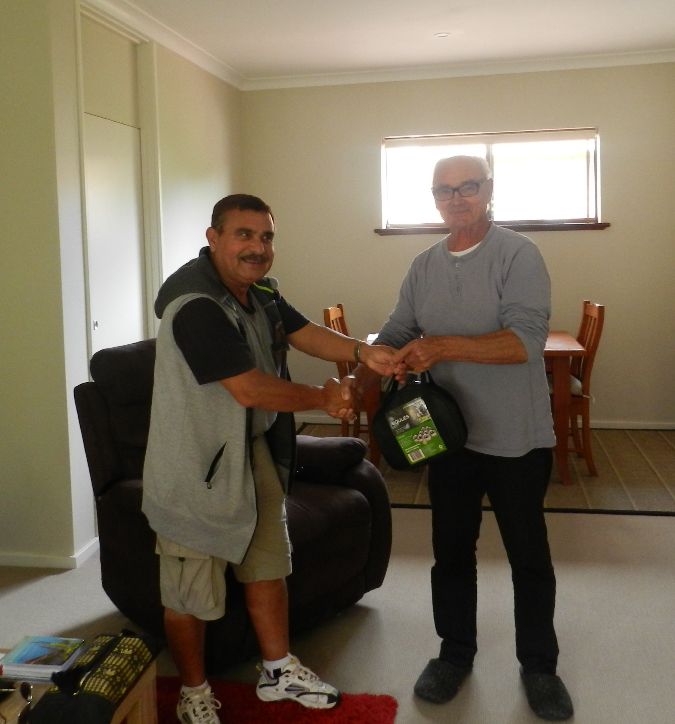 Roger Andreo lucky prize winner who won a set of Petanque Boules at the festival