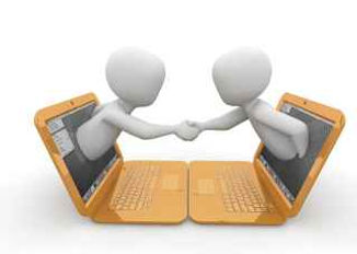 Two figures shaking hands over computers