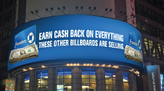 A billboard in the middle of Times Square acknowledging that you can earn cash back on everything else the other billboards around it are selling.