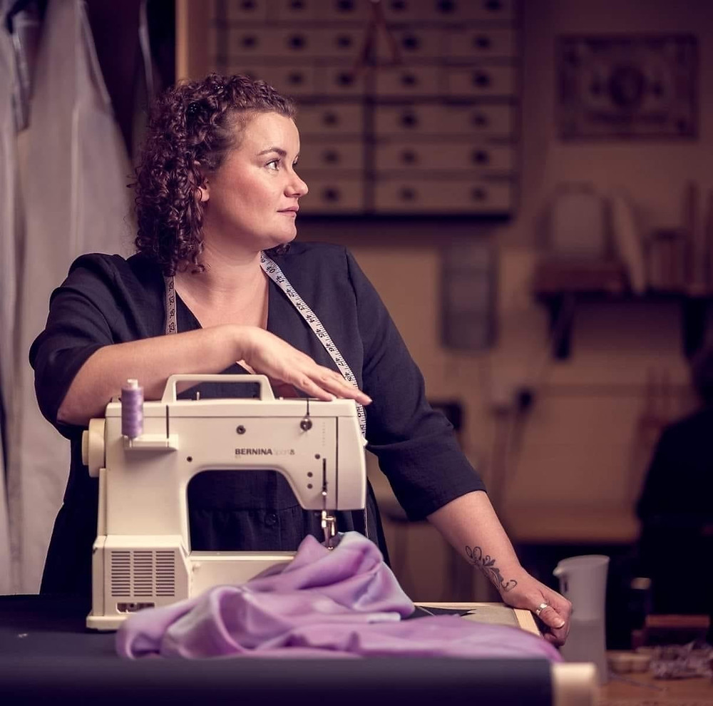 Portrait of Amy with her sewing machine
