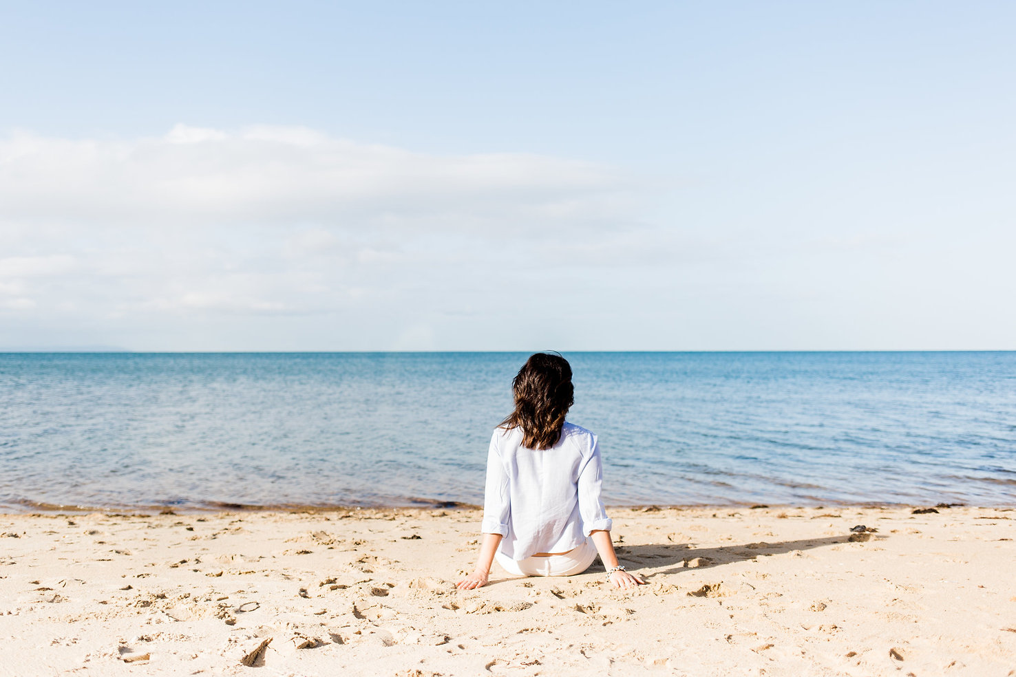 Woman reflecting on beach