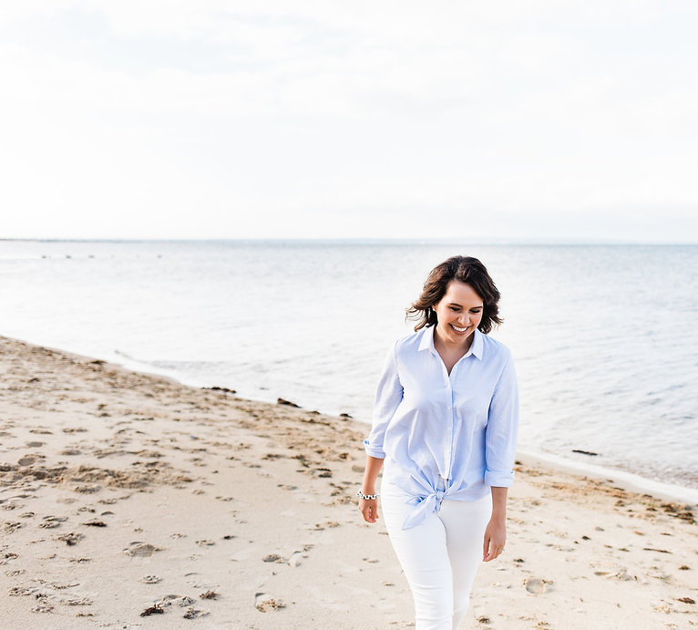 Inspirational woman laughing on beach