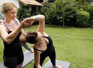 closeup-women-practicing-yoga-outdoor-cl