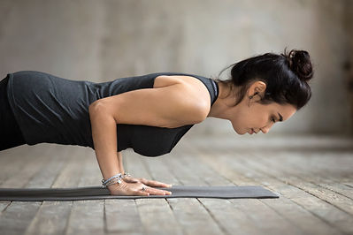 young-yogi-woman-doing-push-ups-press-up