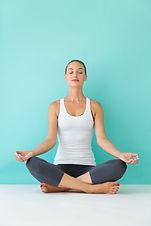 beautiful-young-woman-doing-yoga-home_13