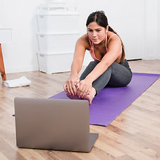 woman-doing-yoga-with-laptop_23-21481086