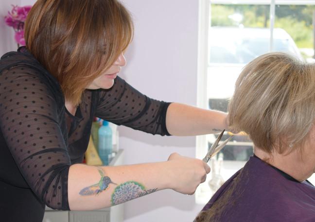 abbigail cutting hair2.jpg