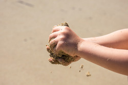 Child's hands playing with sand