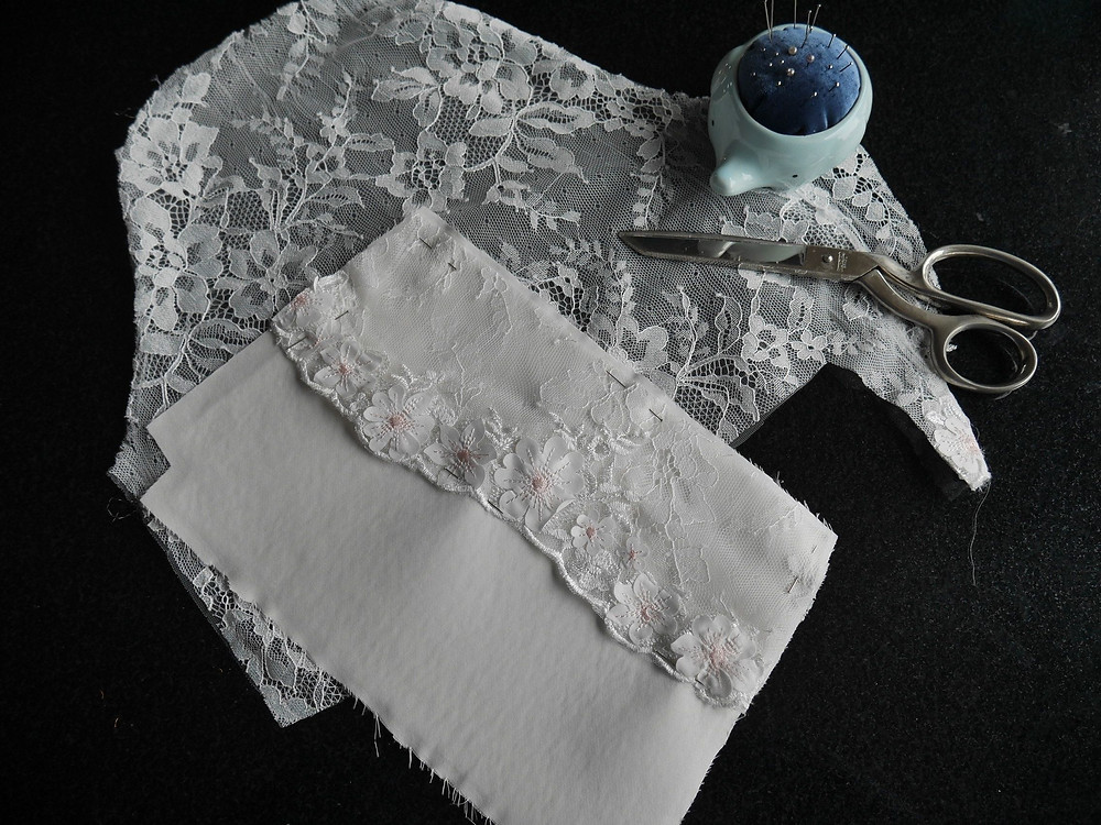 Lace from wedding dress sleeves used to decorate zipped bag