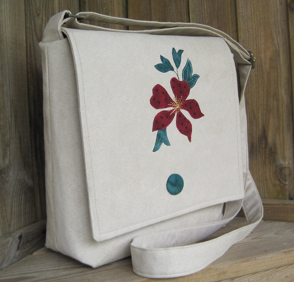 Crossbody bag with appliqued clematis