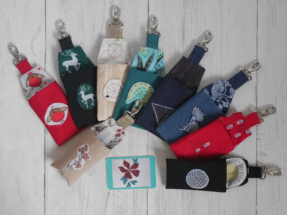 Small pouches with clip and appliqued design by BarMadeBags on Etsy