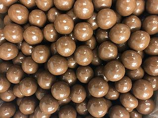 Milk Chocolate Triple Dipped Malt Balls.