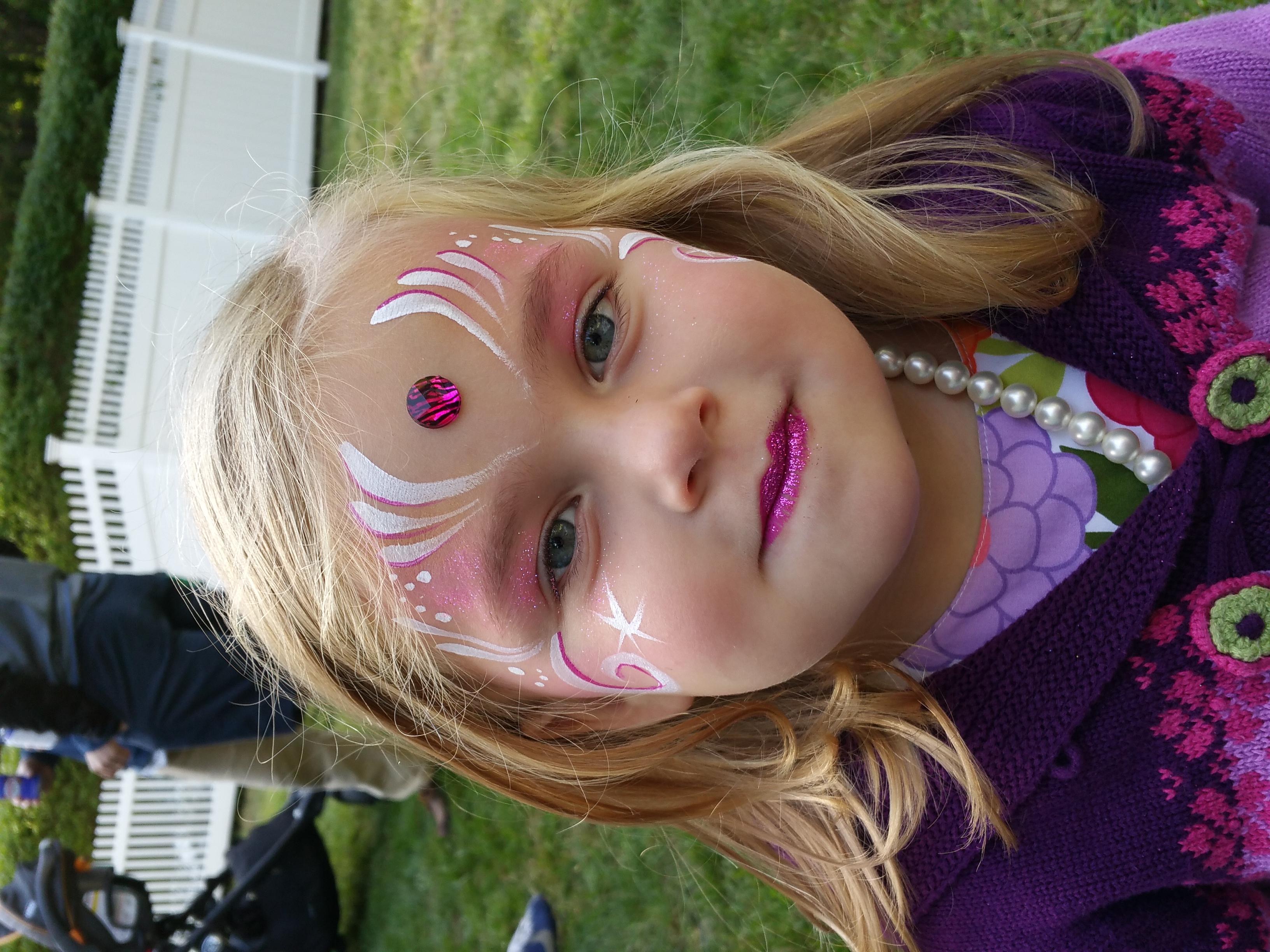 Simple pink face paint design