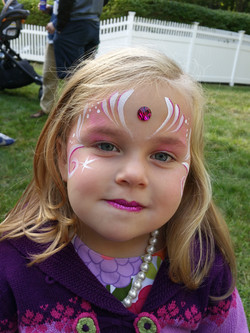 Simple pink face paint design